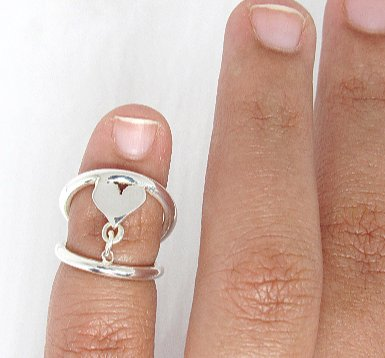 ring splint on pinky with heart design