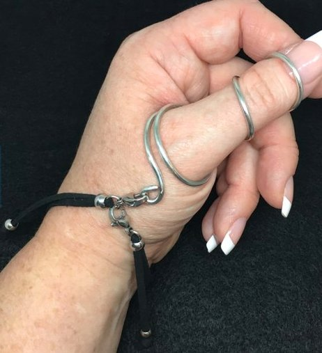 thumb ring splint with black bracelet